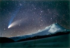 The Hale-Bopp comet over Mt. Hood Oregon in March 1997. Light from a nearby ski area lights the scene. Discover more at www.discoveramerica.com
