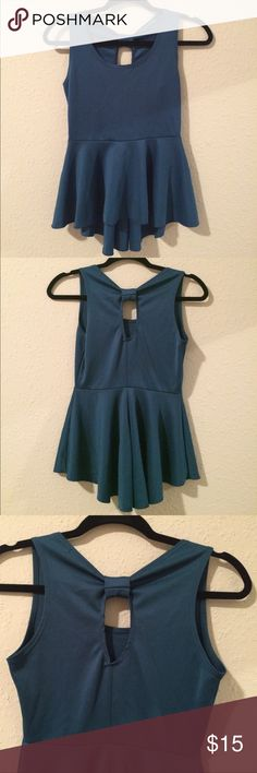 Agua Dark Blue Blouse. Beautiful blouse with little bow on back and semi long tail for elegant look. Julie's Closet Tops Blouses