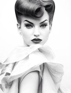 Striking. Vintage inspired hair and makeup.