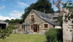 The Comfort Wood Cottage in Metherell, Cornwall, United Kingdom, is an enchanting barn conversion, decorated and furnished to an exceedingly high standard. The Comfort Wood Cottage is both comfortable and spacious, offering delightful countryside views across the enclosed cottage garden. Guests can... #HolidayHomes # # #backpackers #budgetfriendly #traveltips
