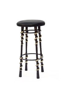 KELLY WEARSTLER   SERPENT BAR STOOL.  Hand-wrought blackened steel legs with bronze serpent-inspired detailing. The seat is upholstered in supple black textured leather.