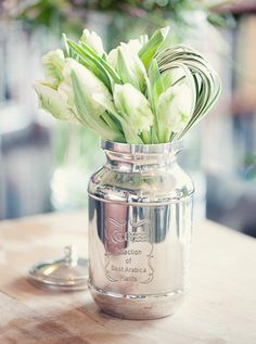 tulips...spraying a mason jar with mercury glass paint would work for replicating this container