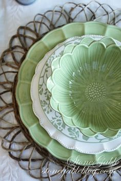 Beautiful flower bowls ...buy plain white, square dinner dishes and buy mixed serving dishes to make a complete set.