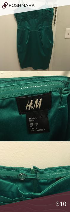 H&M green satin spaghetti strap dress Gently preowned H&M green satin spaghetti strap dress. Some minor piling but overall in beautiful condition. Perfect for any formal occasion! H&M Dresses Prom