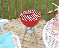 This DIY Toy Grill Lets Kids Play Grillmaster | The grill is comprised of a plastic mixing bowl, a few wooden dowels, an old jar lid and some paint.  Play kitchens for kids are a dime a dozen, but this DIY toy grill encourages kids to cook in the great outdoors. Just be sure to place it a safe distance from the real barbecue grill.