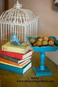Wooden pedestal bowl made from thrift-store bowls, candlesticks, and cheap bases.
