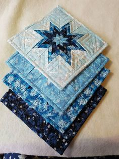 Check out this item in my Etsy shop https://www.etsy.com/ca/listing/476628282/folded-star-hot-pads-potholders-amish