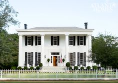 Honeymoon House in Georgia is 5,000 square feet of gorgeousness to see. Note the fence mimics the window pane design