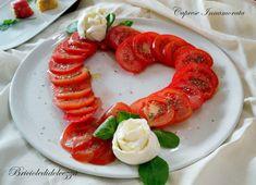 La caprese innamorata non è altro che un'insalata di pomodori a forma di cuore ma la mozzarella di bufala è di rigore!!!