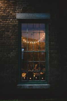 Lights, community and exposed brick. This is what I want my house to look like from the outside.