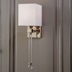 tapered shade for bathroom? Crystal sconce by Regina Andrew.