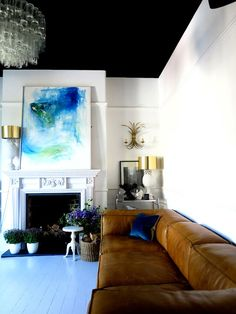 Artwork has wonderful colors and movement. Like the deep colored ceiling and crisp white walls.
