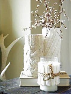 Transform your everyday decorations into cozy trinkets for the holidays! Chop off the sleeve of an old sweater or the cuff of that old knit sock you've been hanging on to in hopes that its twin will someday resurface and place around any vase, candle base, tissue box, soap dispenser (you get the idea!) Make everything look warmer for the cold winter days.
