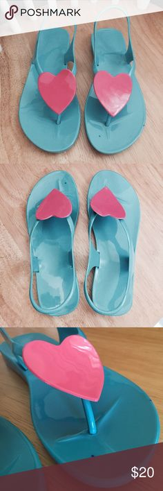 Jelly heart melissa sandals! These sandal thongs are so fun and stylish! Never worn, brand new. There are two little marks on the left shoe, barely noticeable (see pics). No brand, but they are like the super popular melissa shoes. 💓💓 Size 6, true to size. No box. OFFERS WELCOME! Shoes Sandals