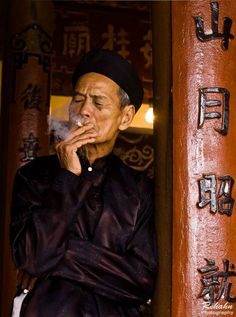 Old man smoking in the temple. Hoi An, Vietnam By Réhahn Photography
