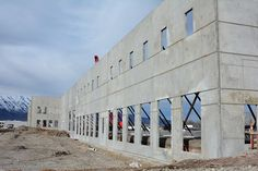 Intermountain Concrete Specialties was happy to provide materials to Eckman & Mitchell Construction of Salt Lake City, Utah to create this building for Malouf Fine Linens in Nibley, Utah. Tilt-up is a construction method where concrete walls are poured on the ground, then tilted up with a crane to the vertical position. #IntermountainConcreteSpecialtes #TiltUp #concrete