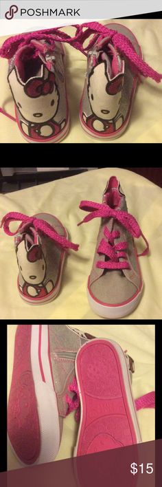 Hello Kitty Hi Tops 10 🎀💞 These are so adorable. They are high top sneakers with HELLO KITTY 🐱 on the back of them. Silver glitter and hot pink shoe laces. These are brand new never worn. Hello Kitty Shoes Sneakers