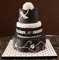 We like the style of this cake, just not all the black. We don't want the guests having black teeth haha