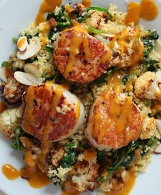 Seared Scallops over Roasted Cauliflower Arugula Couscous with a Curry Emulsion