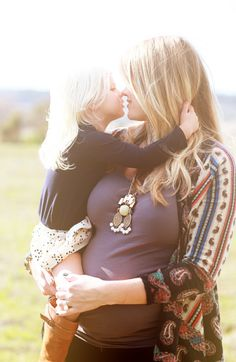 I can't wait to be a mommy.... such a cute picture, and i love her style!