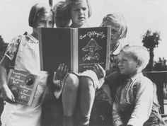 """German children read an anti-Jewish propaganda book titled DER GIFTPILZ ( """"The Poisonous Mushroom""""). The girl on the left holds a companion volume, the translated title of which is """"Trust No Fox."""" Germany, ca. 1938."""