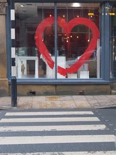 simple heart on glass.Chalk Paint™ works on glass so I could paint a messagee or image directly onto the windows.