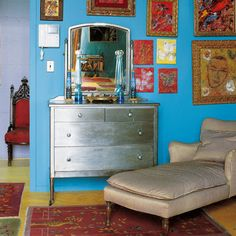 Silver painted dresser..turquoise wall.