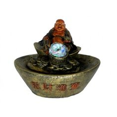 This Lucky Buddha with color LED lights indoor tabletop water fountain are iconic symbol of happiness, good luck, and good fortune. The water comes off the spinning glass ball while the color LED shows glowing effects underneath the glass ball. The Asian writing on the ancient gold ingot meaning bring good fortune. Great for indoor decoration for inside your home.
