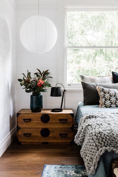 japanese chest nightstand and layered bed | earthy modern house tour coco kelley