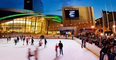 "A Charlotte winter tradition, the annual WBT ""Holiday on Ice"" skating rink, outside the NASCAR Hall of Fame."
