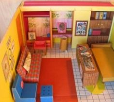 """The Barbie Doll House was brought out in 1962 by Mattel. This is the first house Barbie had since her debut in 1959. It was made totally from cardboard and folded out from the box. Mattel called it """"Barbie's Dream House."""""""