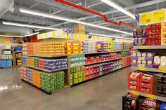 The inside of the new ALDI store in Manhattan, which opened on October (Photo by Amy Sussman/AP Images for ALDI) Convinience Store, Aldi Store, Garage Lighting, Shop Lighting, Outdoor Lighting, Indoor Solar Lights, Supermarket Design, Cool Garages, Led Tubes