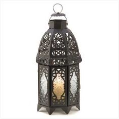 Black Lattice Lantern [13365] : Moorehouse Treasures, Wholesale Home Decor. Magical patterns haunt the night, cast by the intricate panels of this stunning Moroccan marketplace lantern. Adds an instant touch of the exotic to everyday life!