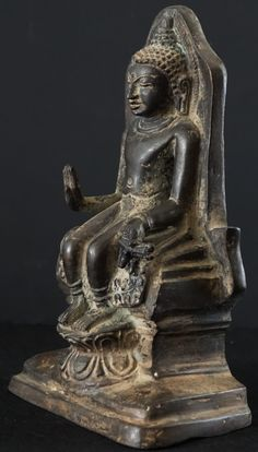 Pre 16th Century Burmese Bronze Pendant legged Buddha seated on throne. The Buddha seated in this fashion is referred to as European fashion.