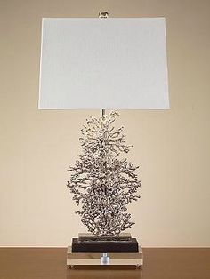 Create a coastal ambiance in any room with the Silver Plated Coral Lamp; a delicately detailed and eye-catching piece sure to garner compliments.