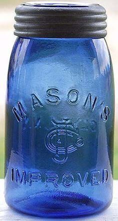 Quart size cobalt blue embossed MASON'S CFJCo IMPROVED on front and CLYDE, N. Comes with a matching cobalt colored, unmarked insert that is perfect, and a good zinc band. Antique Fruit Jar Hall of Fame Antique Bottles, Vintage Bottles, Bottles And Jars, Antique Glass, Glass Bottles, Vintage Mason Jars, Blue Mason Jars, Cobalt Glass, Cobalt Blue