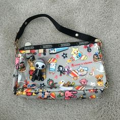LeSportsac x Tokidoki Trasporto mini purse Rare and authentic Tokidoki for LeSportsac Trasporto print mini bag. 9in x 5in x 2in. Used maybe once or twice, like new condition. Includes qee. LeSportsac Bags Mini Bags