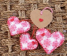 Set of 3 fabric and felt hearts with button detail. £8.95