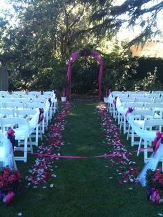 """Lodi wedding. Arch and isle. Hot pinks and purples. Tulle petals bows """"trees"""" for bride and groom to stand by. Crystal Rose Florist Folsom CA"""