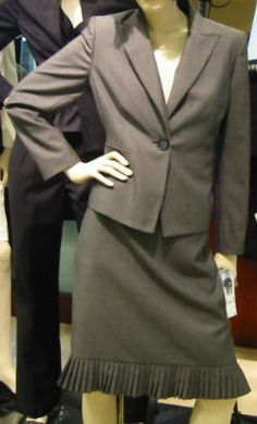 gray woman's business suit with skirt 4