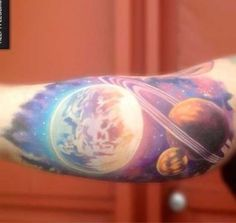 Beautifully Colored Space Tattoo