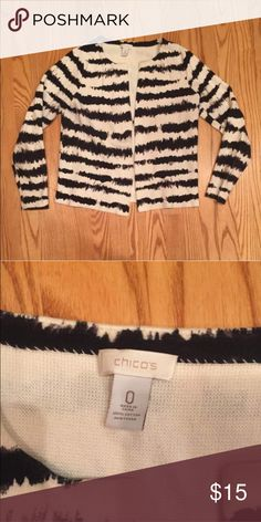 Black & White Sweater Nice weight chico's brand cardigan. Long sleeved, one hook closure, no buttons. Great condition. Chico's size 0 which I think is around a size 8/10. Chico's Sweaters Cardigans