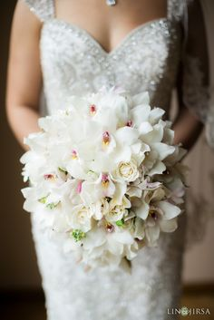 Phalaenopsis orchid and ivory rose bridal bouquet accessoriesed with crystals
