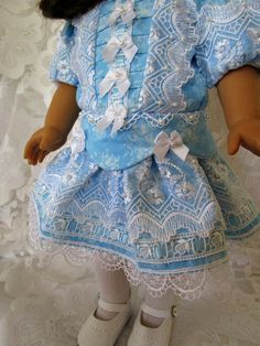 Victorian Little Ladies where dressed with the same style and elegance as the mothers and grandmothers of the day. This wonderfully detail party dress will shine. Made of blue floral printed cotton, embroidered white organza lace, venise lace, blue satin ribbon, white satin and pearl bows and over 150 hand sewn faux pearl beads! The fully lined bodice has a front panel of tiny pleats, organza lace and bows. The dropped waist is accented with a peplum and white bows. White organza lace…