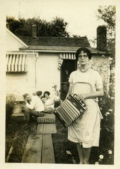 1920s woman with accordion black and white vintage photo by Christian Montone, via Flickr