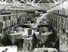 View of a Higgins boat assembly line in Louisiana in the 1940s, from The Digital Collections of the National WWII Museum. 2008.280.002.