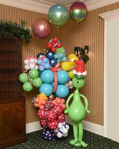 Image may contain: 1 person, indoor Grinch Decorations, Balloon Decorations, Birthday Decorations, Christmas Decorations, Christmas Balloons, Grinch Christmas, Christmas Photos, Balloon Arch, Balloon Garland