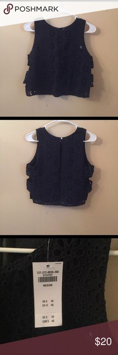 Abercrombie crop top Navy crop top has cutouts on the sides and buttons at the top in the back. Has a lace floral design on it. Never warn. Abercrombie & Fitch Tops Crop Tops