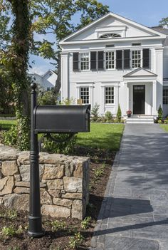 Walking up to the TOH 2019 Idea House, visitors are greeted by a decorative, period-authentic post-mount mailbox made of durable, rustproof aluminum; the matte black finish complements the black shutters and front door to create a stately scene. Window Parts, Mailbox Landscaping, Black Shutters, Double Hung Windows, Mounted Mailbox, Residential Construction, Door Sets, House Numbers, Old Houses