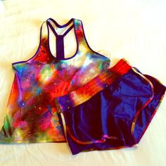 Galaxy Print Workout Set Blue workout top and shorts with great galaxy print on both. Top has print throughout with T strap elastic band in the back to ensure comfortable fit. Running shorts have print on waist band and trim. Heavier material. Dolphin cut with mesh panels on sides. Also have a mesh insert and hidden drawstring. Both size M, bottoms would best fit size S (0-2) and top can fit a size S (loosely) as well  Brand new. All sales final. Please see individual listings for more…